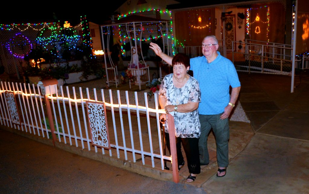 Keith and Judy Everett in front of their Dundas Avenue Christmas lights display.